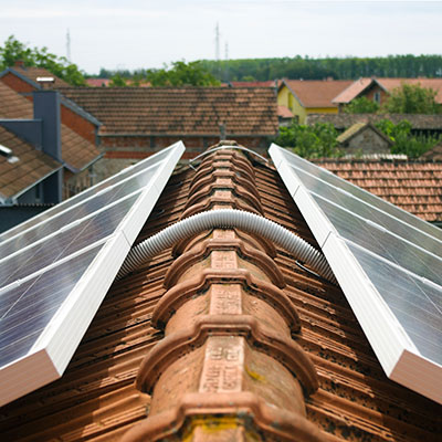 Image of PV solar panels linked to electric combi boilers.